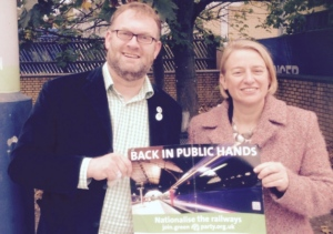 Natalie Bennett poses with a 'renationalise the railways' poster with Green PPC Tony Mabbott. Photo credit: Leighton Buzzard Observer