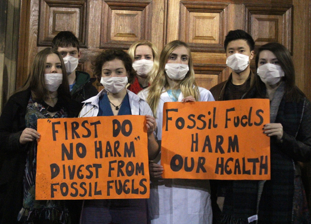 Ele Dow with MedAct members protesting Edinburgh University's investments in fossil fuels. Image: Ric Lander