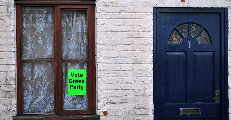 Green Party poster in a window
